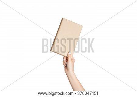 Female Hand Showing Hardcover Paper Book On White Background, Close Up