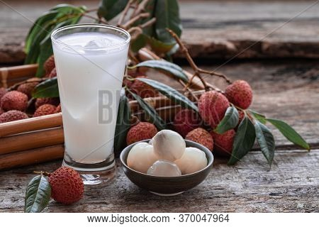 Sweet Lychee Juice On The Wooden Rustic Background Closeup Of Fresh Lychee Juice With Fruits.