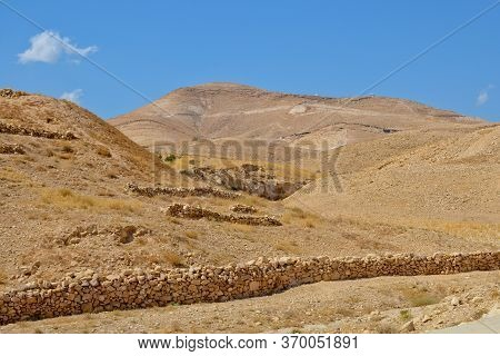 Judean Desert In Israel, Palestine. Rocks And Blue Sky On A Sunny Day. Near The Monastery Of Sava Sa