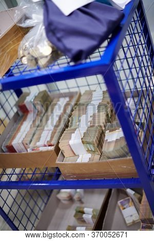 Carton boxes filled with sorted money and stored in the treasury department   sorting and counting money inside bank vault