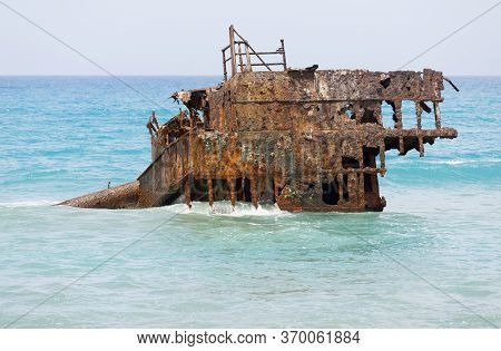 Rusty Ship Wreck Remains Surrounded By Water Near To Cyprus Shores.