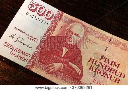 Icelandic Cash. Money Of Iceland. 500 Icelandic Krona Bill On Wooden Table. Icelandic Krona Is The N
