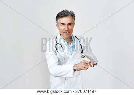 Hurrying To Help. Male Mature Doctor In Medical Uniform With Stethoscope Around Neck Running Against