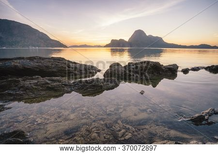 Sunset In El Nido, Beautiful Cadlao Island And Low Tide With Surface Reflection In Foreground. Palaw