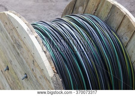 Electric Cable Of Great Length In A Wooden Bay. Laying A New Electrical Cable.