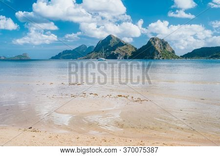El Nido, Palawan, Philippines. Yacht Boat In Lagoon Of Las Cabanas Beach With Amazing Mountains In B
