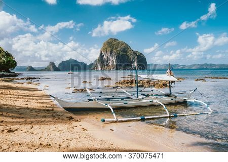 White Banca Island Hopping Boat At Las Cabanas Beach With Amazing Pinagbuyutan Island In Background.