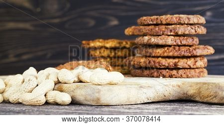 Round Toasted Biscuit And Nutty Crumbs And Whole Peanuts In Baked Goods Made With Oat Flour, Kitchen