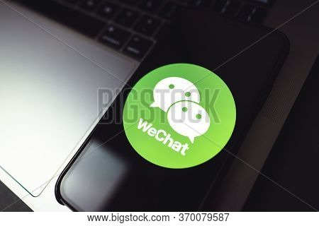 Wechat App Logo On Smartphone Screen. High Quality Photo.