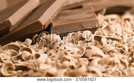 Broken Crumbs Of Delicious Sweet Milk Chocolate During The Preparation Of Desserts, Details Of Sweet