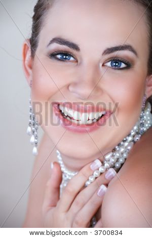 Woman In Pearls Laughing