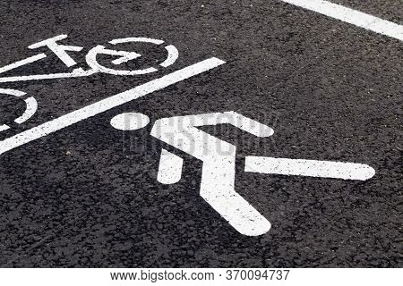 Drawn Symbol Of A Bicycle And Pedestrian On The Territory Of A Combined Bike Path And Road For Pedes