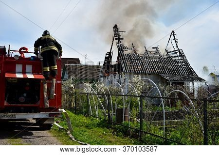 Moscow. Russia. May 2020. Arson Of A Dwelling House. Firefighters Extinguish A Burning House. Insura