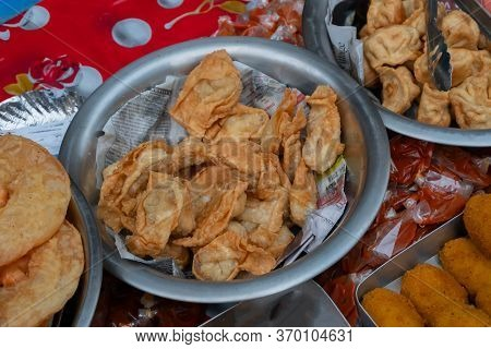 Kolkata, West Bengal, India - 16th December, 2018 : Deep Fried Pork Momo, Fresh Chinese Food Being S