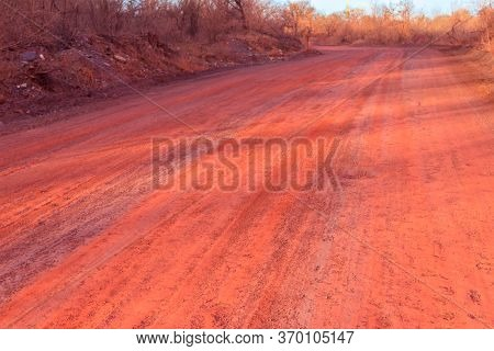 Red Dirt Road Polluted With Iron Ore Near Iron Ore Quarry In Kryvyi Rih, Ukraine