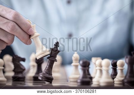 Businessman Play With Chess Game In Competition Success Play, Concept Strategy And Successful Manage