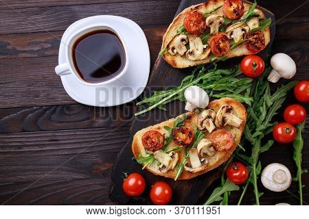 Tasty Homemade Italian Antipasti Grill Bruschetta With Chopped Tomatoes, Champignons And Arugula, He