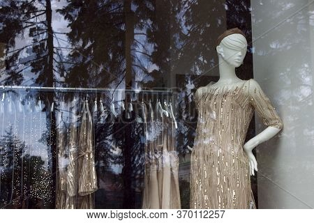 Female Mannequin In A Beautiful Beige, Golden Elegant Evening Cocktail Dress With Sequins. Shop Wind
