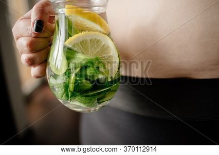 Detox And Hydration. Overweight Woman Drinking Infused Water. Belly Fat, Weight Loss, Water Balance
