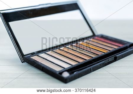 Palette Of Eyeshadows In Brown Tones, Matte And Shimmer Eyeshadows On A White Background, Close Up.