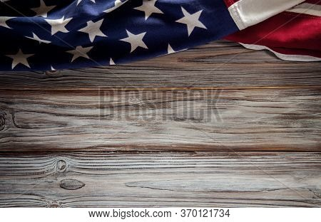 Usa Flag Lying On Wooden Background. American Symbolic. 4th Of July Or Memorial Day Of United States