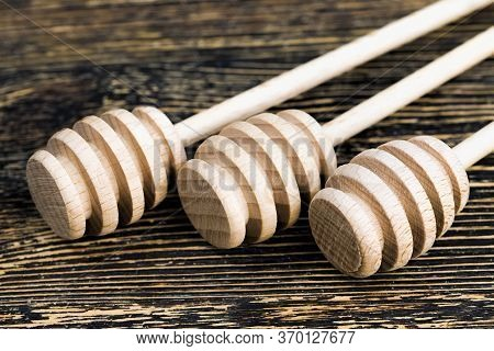 A Few Simple Wooden Sticks For Honey, A Close Up Of Useful Items In Beekeeping