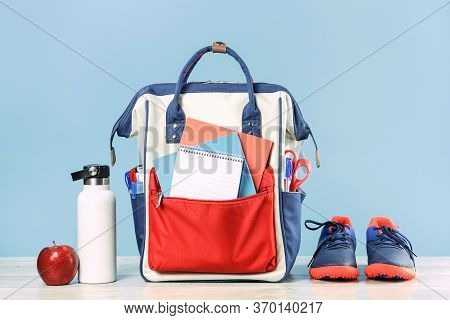 Backpack With School Red And Blue Stationery Supplies, Notebooks Pencils Scissors With Red Apple On