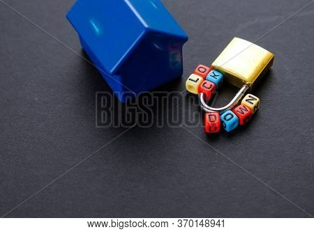 Conceptual Of Lockdown During Pandemic Declared By Who. Low Key Image. Alphabet Beads And Padlock On