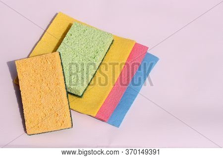 Colored Sponges For Cleaning Dishes On A White Background. Sponges For Washing Dishes.