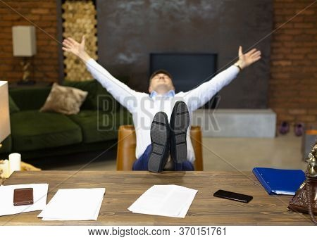 Happy Businessman Put His Feet On The Table. Rest After Successful Negotiations And Contracting. Foc