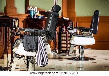 Barbershop Armchair, Modern Hairdresser And Hair Salon, Barber Shop For Men. Beard, Bearded Man. Sty