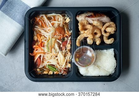 Set Of Papaya Salad With Sticky Rice, Grilled Chicken And Pork Rind In Take Away Lunch Box