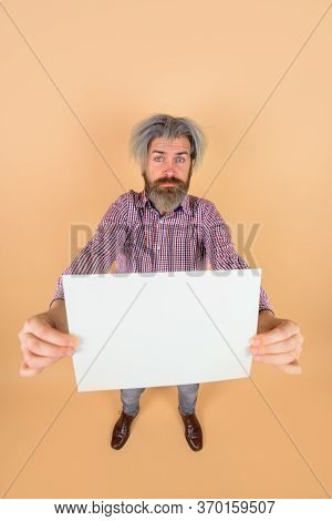 Advertising Banner. Confused Man With Blank Board. Handsome Man Shows Empty Board. Ready For Your Te