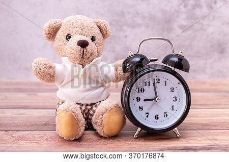 Teddy Bear And Clock On Table Wooden. Valentine's Day Celebration