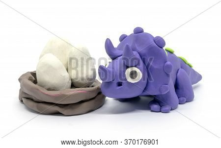 Play Dough Triceratopson And Egg On White Background