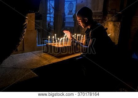 Jerusalem. Israel .11 September 2014.the Pilgrims Lit Candles At The Church Of The Holy Sepulchre In