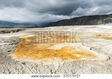 Vivid Canary Spring area at thermal terraces rock formations in Mammoth Hot Springs, Yellowstone National Park. USA.