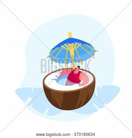 Summer Time Vacation Relax. Young Man In Swim Suit Relaxing In Huge Coconut With Umbrella Decoration
