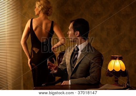 Man in suit with woman behind him