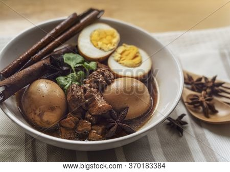 Homemade Food, Stewed Pork And Eggs With Herb In Sweet Brown Soup, Thai Traditional Food, Local Or S