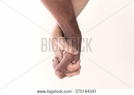 Anti Racism And Friendship Symbol. White And Black Couple Holding Hands.