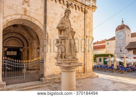 Statue of St Lawrence with Clock tower at background in Trogir, Dalmatian Coast, Croatia