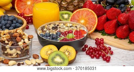 Group Fruits Breakfast Mixed Vegetables With Salad Bowl, Nuts Bowl, Strawberry, Banana, And Pineappl