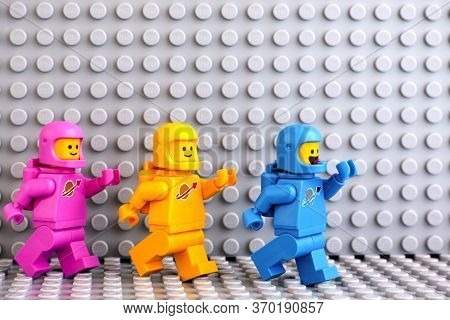 Tambov, Russian Federation - June 04, 2020 Three Lego Astronaut Minifigures Going One After Another