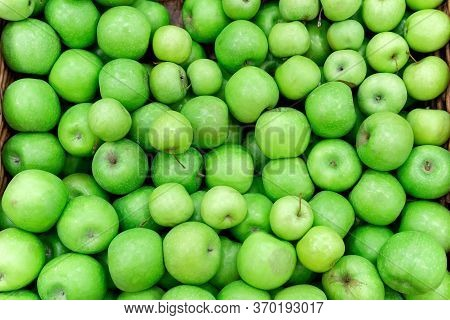 Green Apples In The Market. Apples Lie In Boxes In Front Of The Buyer. Healthy Food