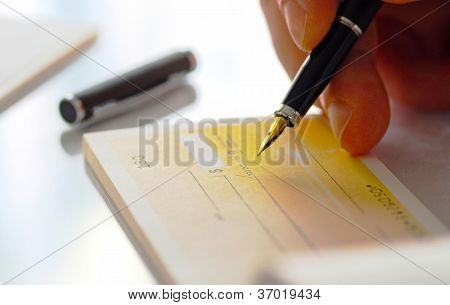 Business man prepare writing a check