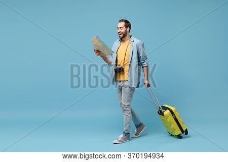 Traveler Tourist Man In Yellow Summer Casual Clothes With Photo Camera Isolated On Blue Background.