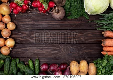 Topview. Fresh Vegetable On Wooden Table. Farm Products