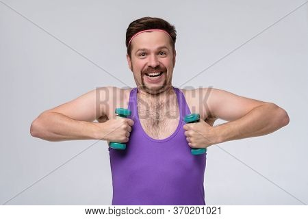 Athletic Funny Young Man Doing Exercise Dumbbell
