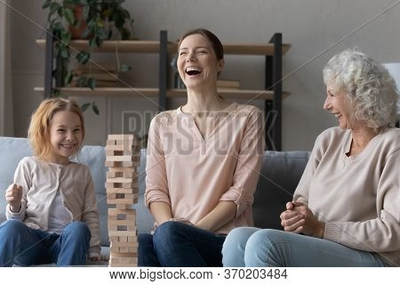 Overjoyed Three Generations Of Women Playing Together